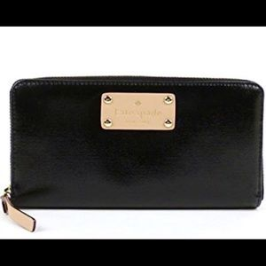 Kate Spade Ziparound Wallet. Black coated canvas.